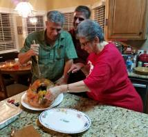 How many does it take to carve a turkey? Vinnie with brother Michael and sister Annmarie in 2016.
