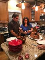 Roselee and her brother Vinnie discuss carving the bird.