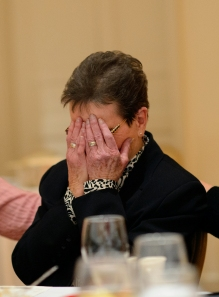 Frances Woody reacts as she is announced as the Kiwanis Club of Burlington Citizen of the Year during a banquet at Alamance Country Club in Burlington Thursday evening. Photo Scott Muthersbaugh.